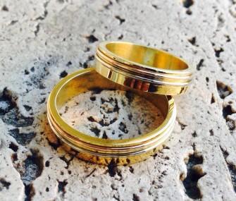 Fedi in oro con fili in bronzo e argento